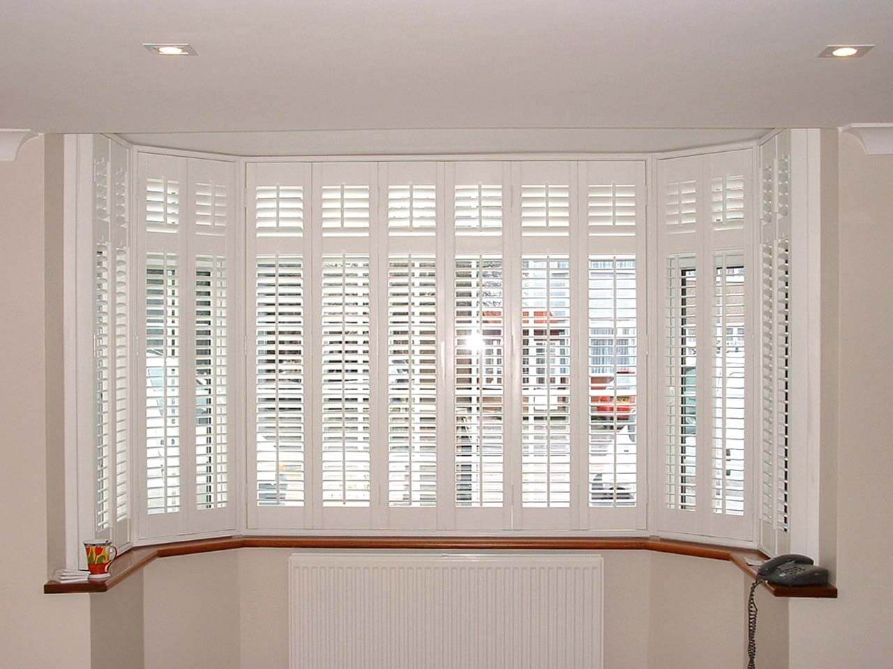 Interior blinds 2017 grasscloth wallpaper for Window shutters interior prices