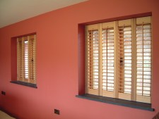 Oiled cedar full height interior shutters