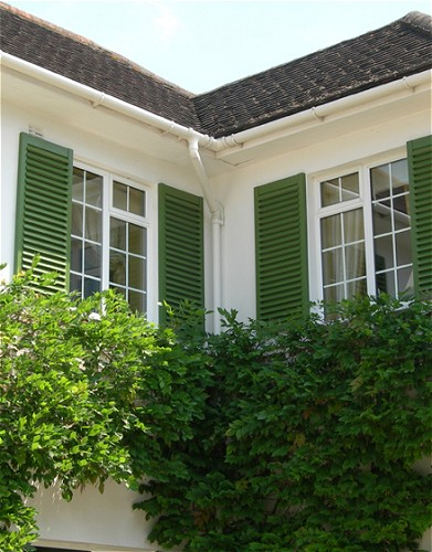 Town country exterior window shutters by simply shutters uk for Country shutters