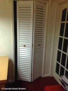 white painted wooden louvre cupboard door