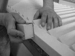 close up hand sanding louvre shutter