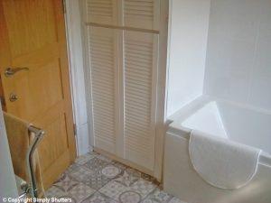 white louvre door on bathroom cupboard