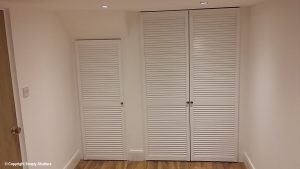 white louvre doors over cupboard opening
