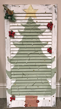 louvre door with a painted Christmas tree on the front