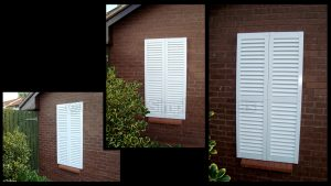 Using decorative shutters as a window covering.