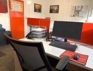 office desk with orange accents and door