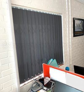 closed grey blinds over window