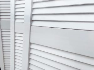 close up offset horizontal bar on white louvre door