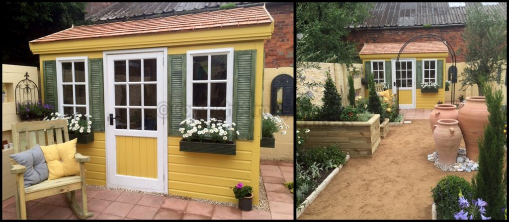 yellow garden shed with green shutters