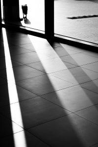 sun shining through window on tiled floor