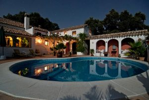 white villa home with swimming pool